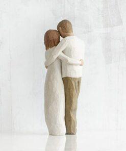 New parents & baby sculpture